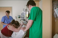 Pushing on hands and knees with an epidural.